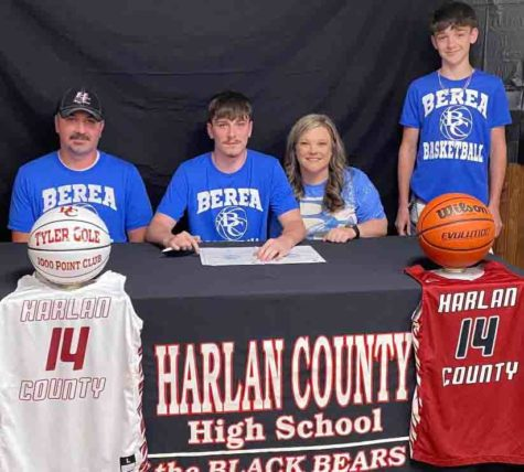 Harlan County High School senior Tyler Cole signed recently with Berea College to continue his basketball career. Cole is pictured with his parents, Jeff and Ashley, and his brother, Trenton.