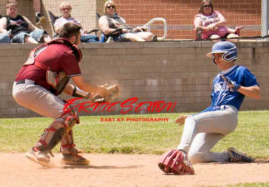 Letcher Central's Ethan Brown beat the throw to Harlan County catcher Isaac Kelly in Saturday action at HCHS.