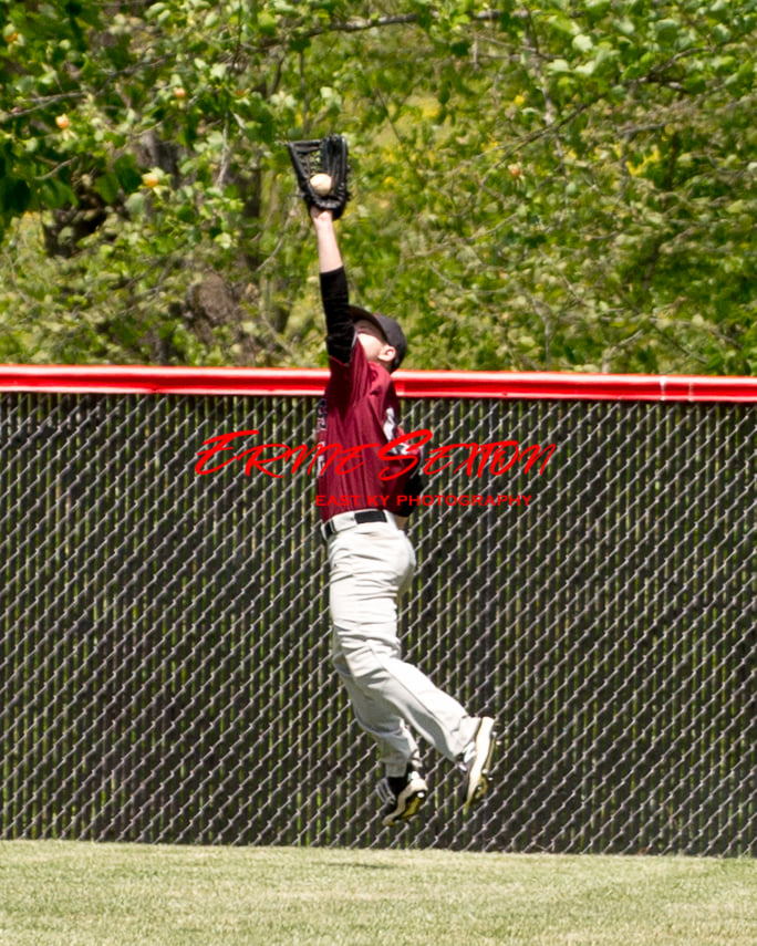 Harlan County outfielder Jacob Brown went airborne for a catch during Saturday's doubleheader.