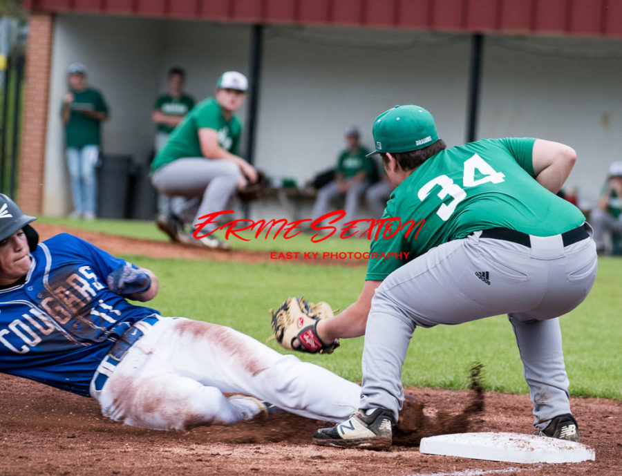 Letcher Central's Jonah Little slid into third base as Harlan's Andrew Roark took the throw in action last week.