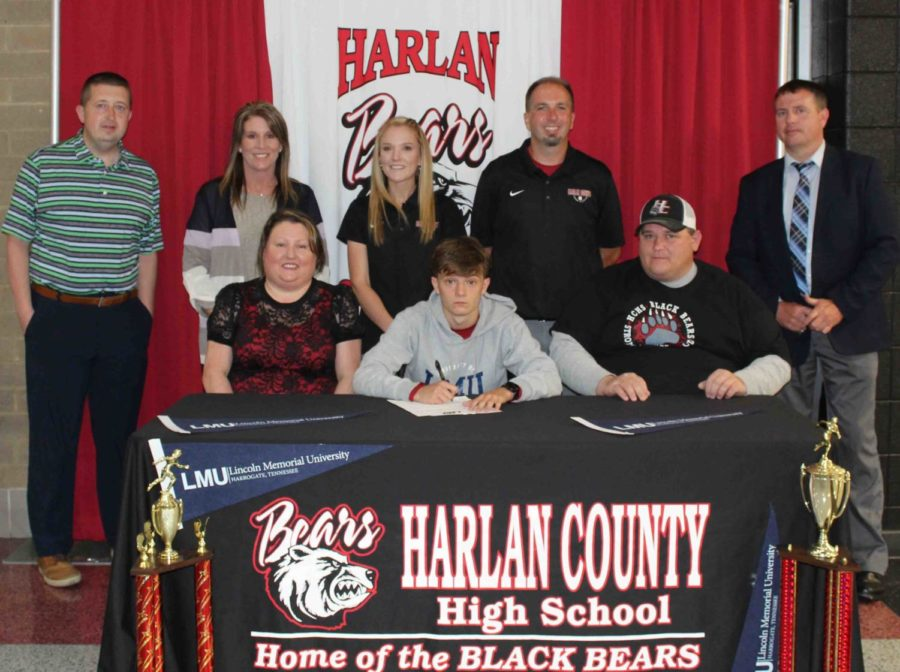 Harlan County High School senior Caleb Rigney signed with Lincoln Memorial University on Monday to continue her track career. Pictured with Vitatoe at the signing ceremony are his parents, Heather and Jack Rigney, as well as HCHS athletic director Eugene Farmer, HCHS assistant coach Arynn Johnson, HCHS Principal Kathy Minor, HCHS track coach Ryan Vitatoe and Harlan County Schools Superintendent Brent Roark.