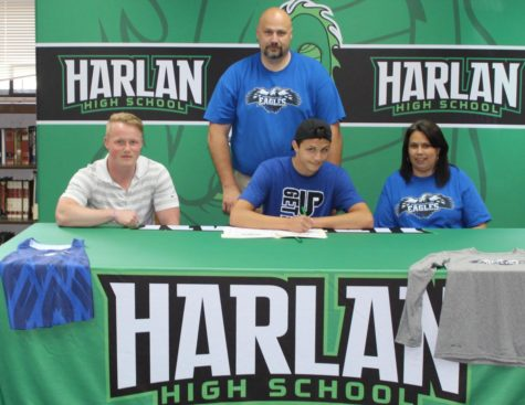 Britt Lawson IV signed Friday to continue his track career at Alice Lloyd College. Pictured with Lawson at the signing ceremony are his parents, Britt III and Shannon Lawson, and Alice Lloyd coach John Driskill.