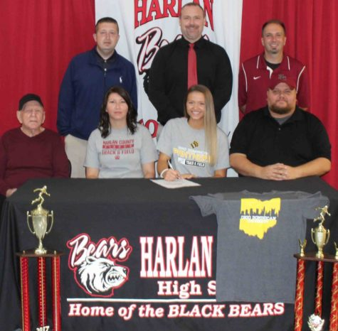 Harlan County High School senior Kassy Owens signed with Ohio Dominican University on Friday in ceremonies at HCHS. Owens is pictured with her parents, Joe and April Owens, and her grandfather, Howard Hensley, as well as HCHS athletic director Eugene Farmer, HCHS assistant principal Mike Hensley and HCHS track coach Ryan VItatoe.