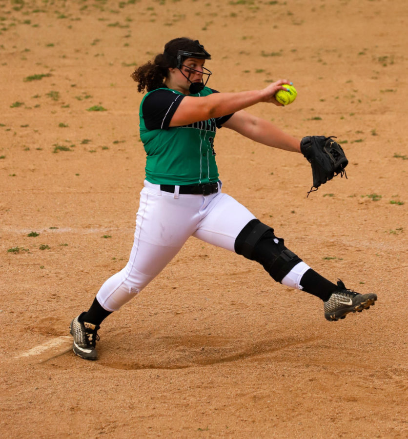 Harlan eighth-grader Carley Thomas delivered a pitch in Monday's game against Letcher Central.
