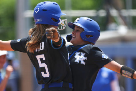 Tatum Spangler and Lauren Johnson celebrated after the Wildcats defeated Notre Dame in the first of two games Sunday at Joe Cropp Stadium in Lexington.