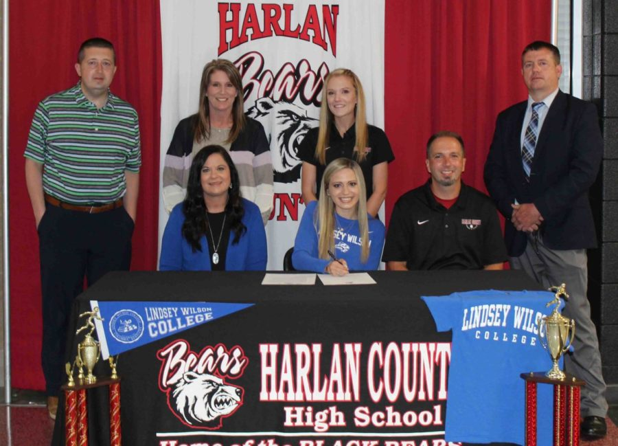 Harlan County High School senior Abby Vitatoe signed with Lindsey Wilson College on Monday to continue her track career. Pictured with Vitatoe at the signing ceremony are her parents, Fran and Ryan Vitatoe, as well as HCHS athletic director Eugene Farmer, HCHS Principal Kathy Minor, HCHS assistant coach Arynn Johnson and Harlan County Schools Superintendent Brent Roark.