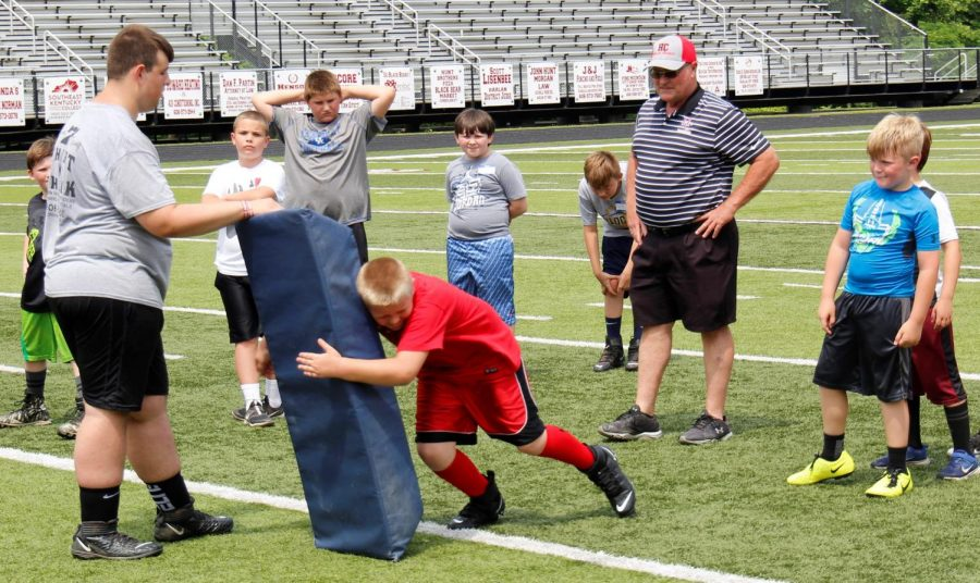 First-year Harlan County High School football coach Amos McCreary instructed participants in the Black Bears Football on Saturday on the fundamentals of tackling.