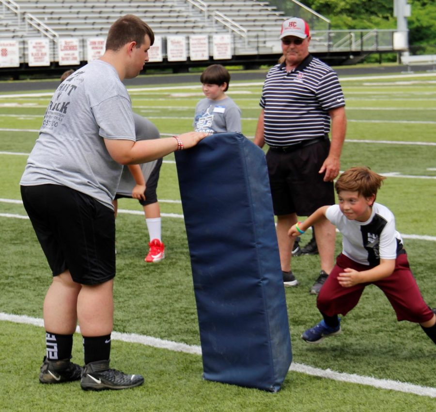 Participants in the Black Bears Football Camp worked on tackling drills under the direction of HCHS football coach Amos McCreary.