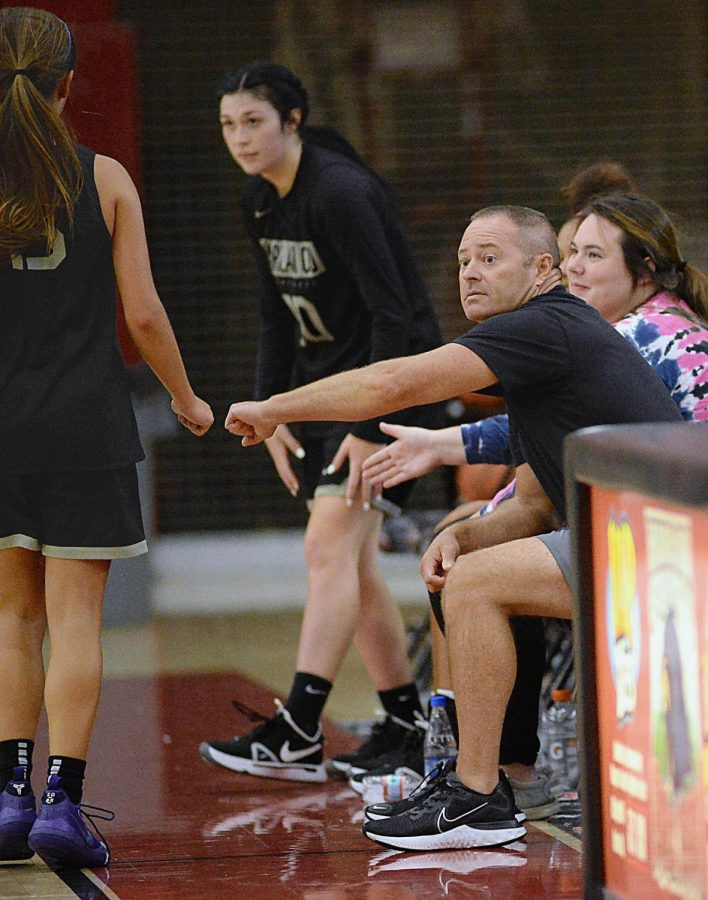 Harlan County coach Anthony Nolan congratulated guard Ella Karst as she returned to the bench in scrimmage action Tuesday. The Lady Bears rolled to a 63-38 win.