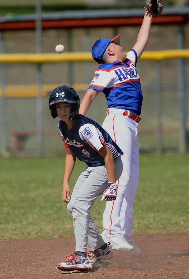Harlan All-Stars infielder Andrew Vance stretched for errant throw in Area 4 Tournament action Saturday.