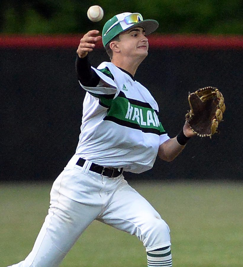 Harlan third baseman John Mark Bryson made a throw to retire a Harlan County base runner in district tournament action Monday.