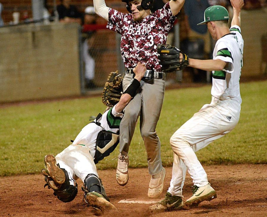 Harlan County's Josh Swanner beat the tag of Harlan catcher Noah Lewis on a wild pitch in the seventh inning of Monday's 52nd DIstrict Tournament game. The Bears rallied with five runs in the inning to win 5-4 and advance to Tuesday's championship game against Middlesboro.
