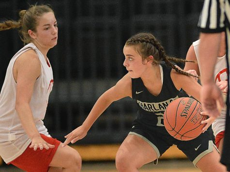 Harlan County freshman Kylie Jones worked around a Lee, Va., defender in scrimmage action Tuesday. The Lady Bears won 63-38.