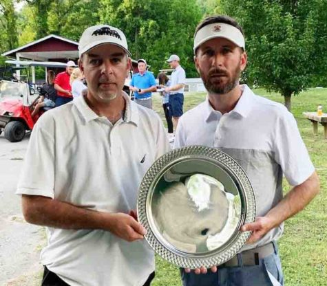 Matt Gann (right) received a trophy from Harlan County Club board member Andrew Forester for winning the Harlan Invitational on Sunday.