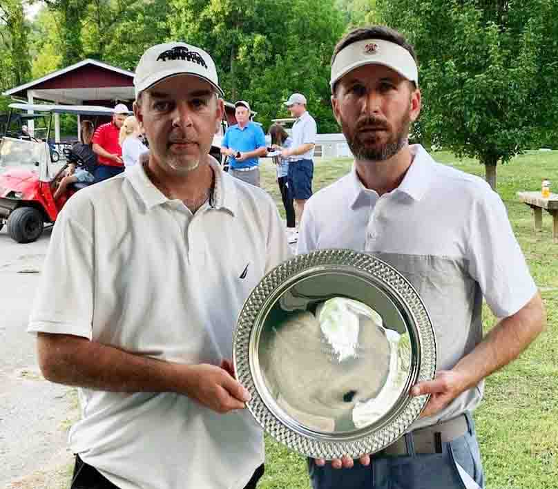 Matt+Gann+%28right%29+received+a+trophy+from+Harlan+County+Club+board+member+Andrew+Forester+for+winning+the+Harlan+Invitational+on+Sunday.