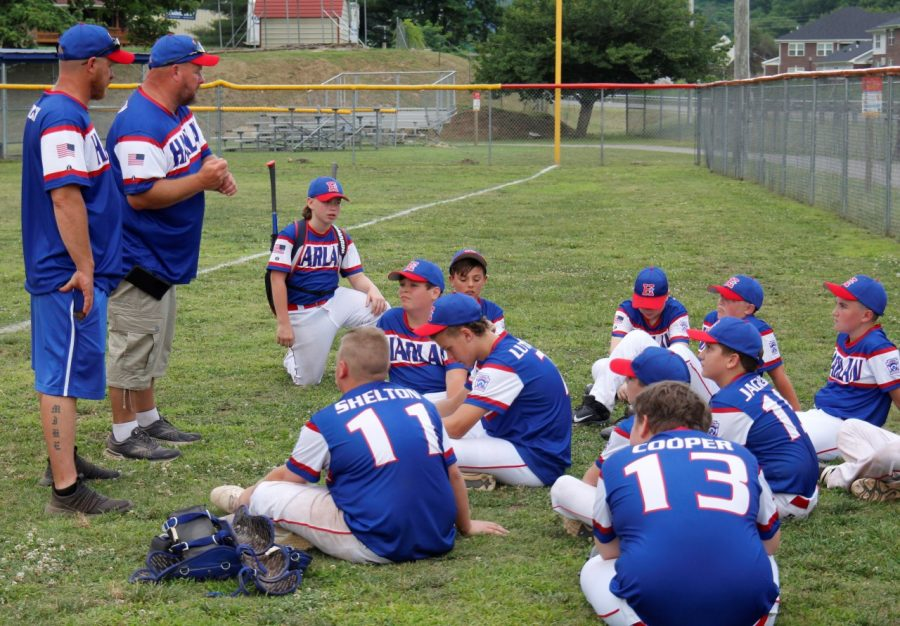 Harlan All-Stars coach Brad Shelton talked to his team after an 18-4 win over Leslie County to take second place in the Area 4 Tournament at Huff Park.