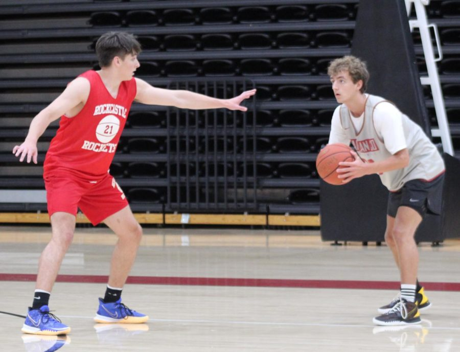 Harlan County senior guard Jackson Huff prepared to pass around a Rockcastle County defender in scrimmage action Thursday. Huff scored 25 points in the Bears' 64-61 win.