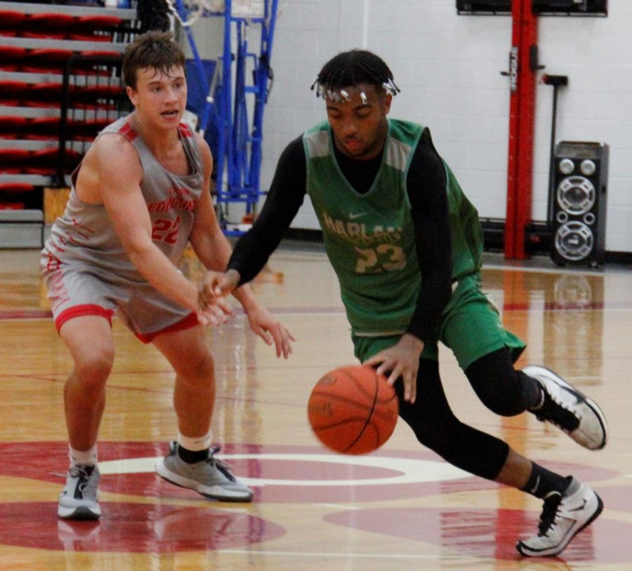 Harlan junior forward Jaedyn Gist worked around a Corbin defender in scrimmage action Monday. Gist scored nine points in the Dragons' 68-62 victory.
