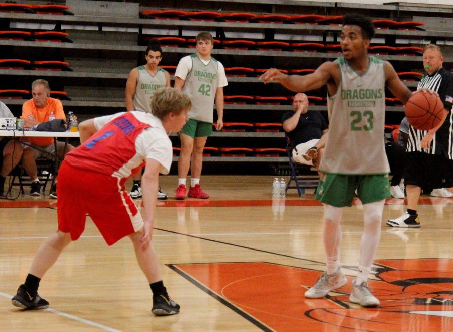 Harlan junior forward Jaeden Gist directed traffic as he set up a play in scrimmage action at Williamsburg. The Dragons fell 68-35 to Jackson County.