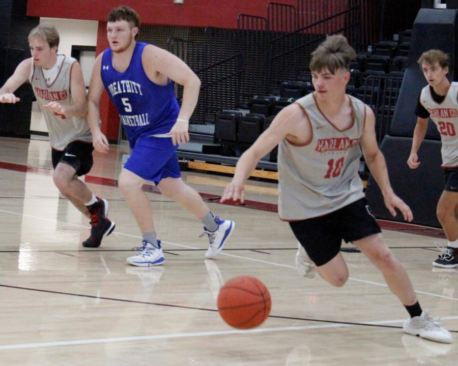 Harlan County sophomore guard Jonah Swanner started a fast break in scrimmage action Monday against Breathitt County. The Bears lost 56-55 on a basket by Breathitt in the closing seconds but bounced back with a 57-49 win over Bell County.