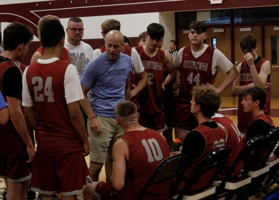 Harlan County coach Michael Jones talked with his team during summer scrimmages Tuesday at Leslie County. The Bears closed the summer with a 13-7 record.