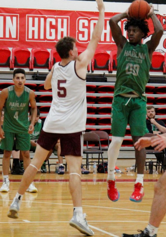 Harlan's Jordan Akal went up to make a pass in scrimmage action against Pulaski County. Akal poured in 33 points, but Pulaski rallied from a 13-point deficit to win 81-67.
