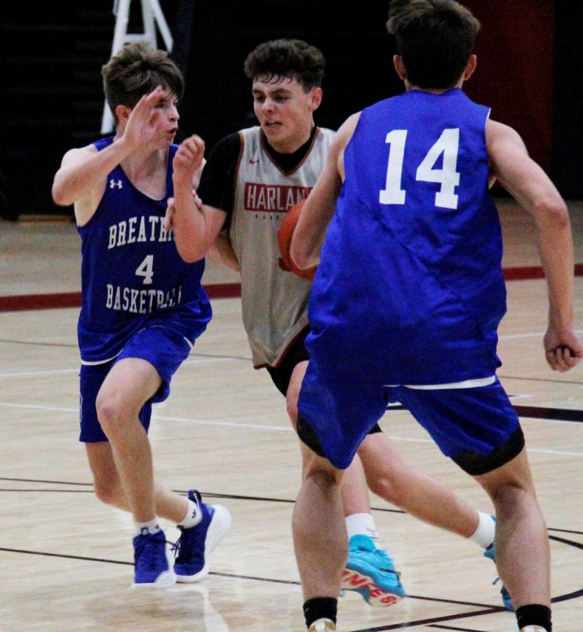 Harlan County freshman guard Maddox Huff worked to the basket in action earlier this summer. The Black Bears split four varsity scrimmages over the weekend in Lexington.