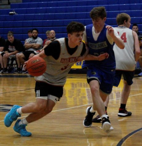Harlan County guard Maddox Huff worked around a North Laurel defender in scrimmage action Tuesday. Huff forced overtime with a 3-pointer and hit the winning free throws in overtime as the Bears edged the Jaguars 60-58.