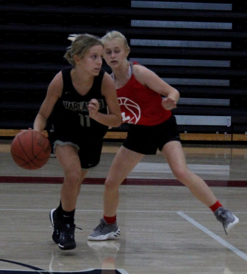 Harlan County freshman Peyton Lunsford worked around a Lee defender in a scrimmage game Tuesday. The Lady Bears won both junior varsity and varsity scrimmages.