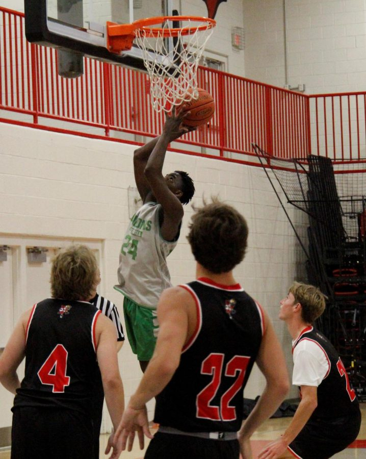 Harlan forward Will Austin went inside for two points in scrimmage action against South Laurel.