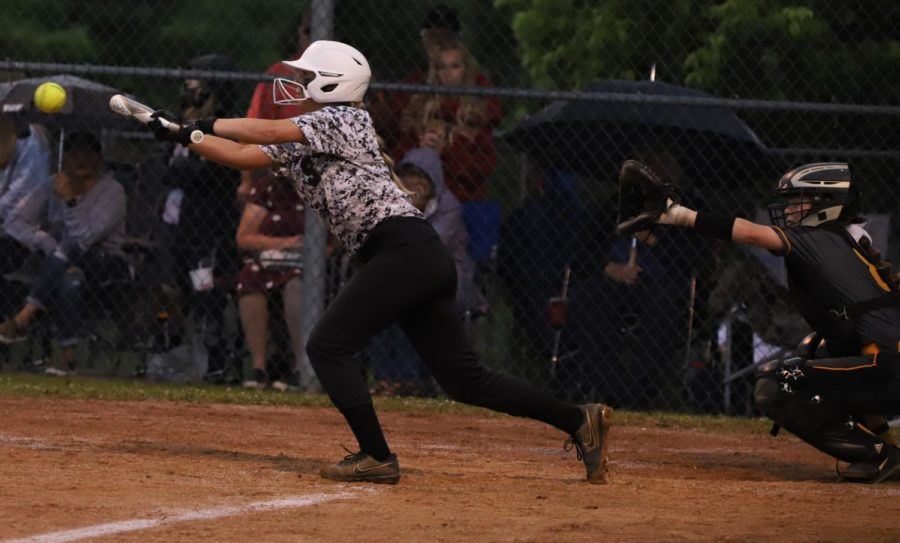 Harlan County's Hailey Austin laid down a bunt in the 52nd District Tournament championship game Wednesday.