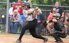Harlan County's Honesty Thomas connected on a pitch in district tournament action Wednesday. The Lady Bears were limited to three hits in a 14-4 loss.