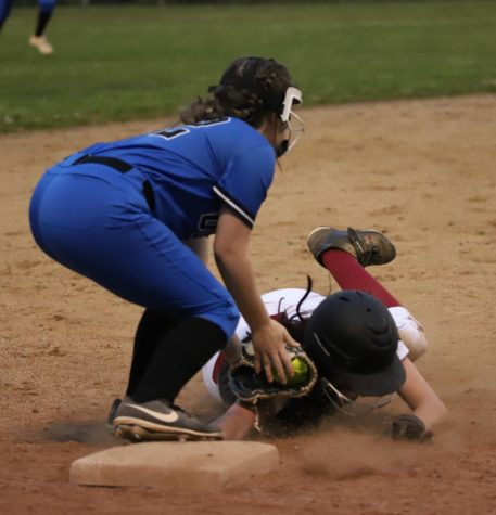 Harlan County outfielder Jacey Lewis was called out at third base as she tried to stretch a double into a triple during 52nd District Tournament action Tuesday against Bell County. Lewis had three hits in the Lady Bears