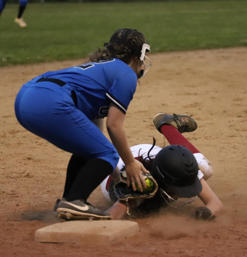 Harlan County outfielder Jacey Lewis was called out at third base as she tried to stretch a double into a triple during 52nd District Tournament action Tuesday against Bell County. Lewis had three hits in the Lady Bears' 5-1 win.