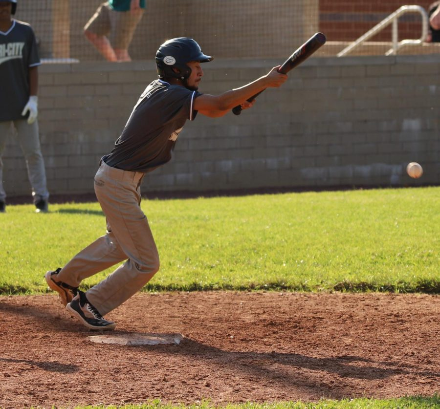 Tri-City Senior League All-Star Junior Sanchez laid down a bunt in action earlier in the week at Harlan County High School.