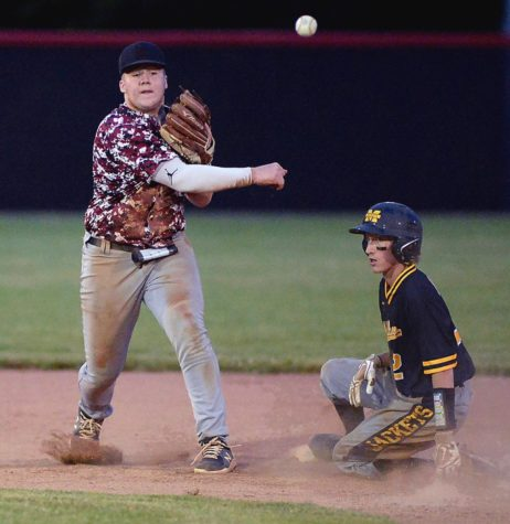 Harlan County shortstop Zac Collett threw to first base after recording an out in Tuesday