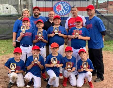 Tim's Barbershop won this year's minor league division of the Harlan Little League. Team members include, from left, bottom row: Colt Perkins, Landon Smith, Nate Thomas, Seth Johnson and Easton Clem; middle row: Logan Mills, Brantley McArthur, Brylee Southerland and Tate Hoskins; back row: coaches April Southerland and Chris Southerland, sponsor Tim Howard, coaches John Clem and Steve Johnson.