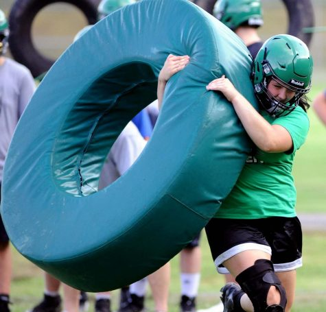 Harlan junior Hanna Pace worked through a tackling drill at a recent practice session.