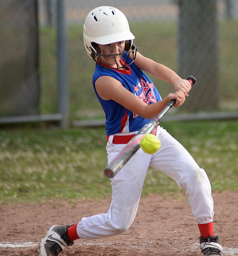 Adelynn Burgan, of the Harlan All-Stars, connected on a pitch in District 4 Tournament action against South London on Wednesday. South London advanced with a 13-3 victory.