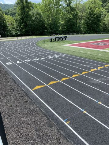 """Midwest Track Builders, of Chicago, recently completed an entire resurfacing project at Coal Miners Memorial Stadium on the campus of Harlan County High School. """"A huge amount of credit goes to Mr. Brent Roark and the Harlan County Board of Education for approving a project of this magnitude,"""" said HCHS athletic director Eugene Farmer. """"Although well-maintained, the track needed the resurfacing which provides a softer, more gentle surface for our student-athletes to compete on. This project was years in the making and when you think about track resurfacing nationwide, it really doesn't get any more quality than Midwest Track Builders. I'm certainly pleased for both our student-athletes and coach Vitatoe, who always does a first-class job leading our track and field teams."""""""