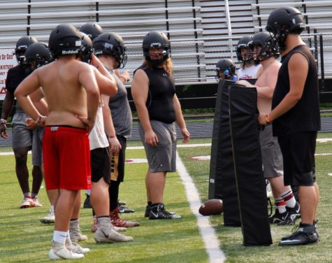 Harlan County senior center Ethan Shepherd prepared to snap the ball during a practice session earlier this summer. Shepherd is a returning starter on the Bears' line.