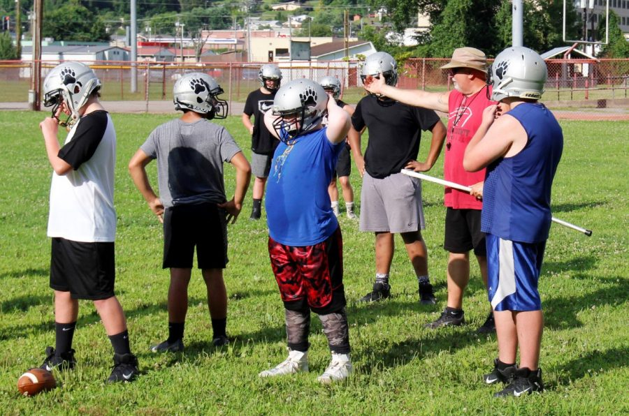 Harlan County coach Scott Caldwell talked with members of the eighth-grade offensive unit during a practice session Monday. The Black Bears will compete in the Cumberland Valley Conference this season.