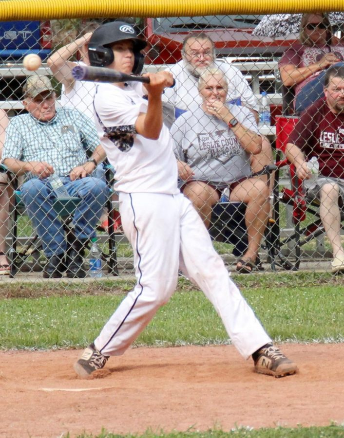 Jake Brewer went after a pitch in action from the District 4 Tournament at Leslie County High School. Brewer had hits in both games, but Tri-City fell twice to Leslie County.