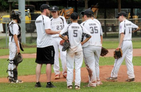 Tri-City Junior League coach Matt Duckworth talked with his infielder during a break in the District 4 Tournament at Leslie County.