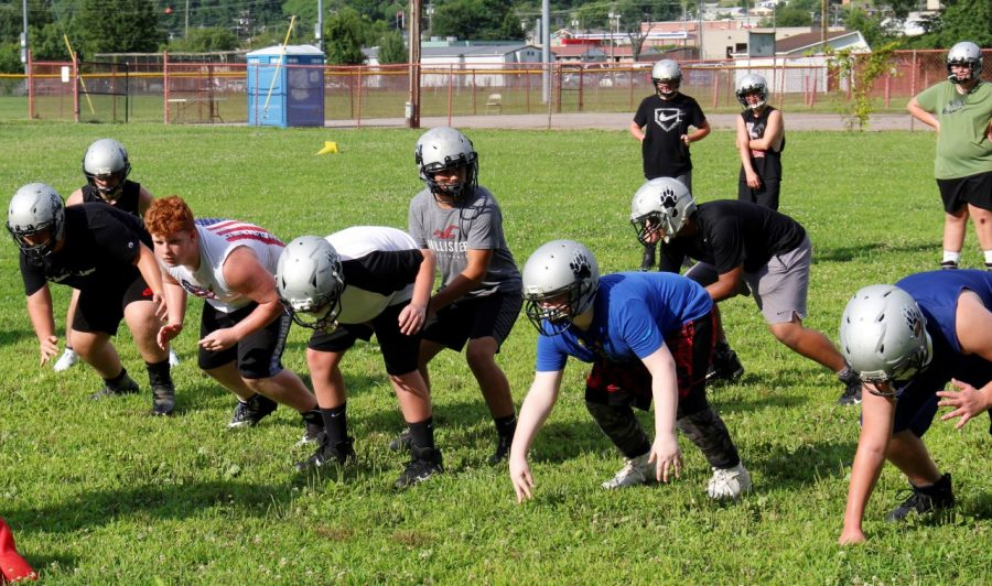 Michael Torres took the snap at quarterback in Harlan County's middle school practice earlier in the week.