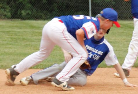 Riley Monhollen, of the Pineville/Bell All-Stars, was safe at second as Harlan All-Stars shortstop Brayden Morris made the tag.