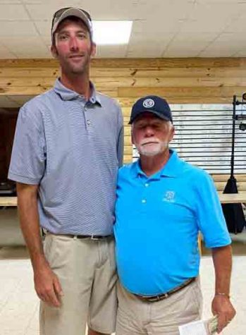 Justin Charles, of Winchester, was the winner of the annual Lynch Invitational Tournament on Sunday. He is pictured with club member Rainbo Johnson.