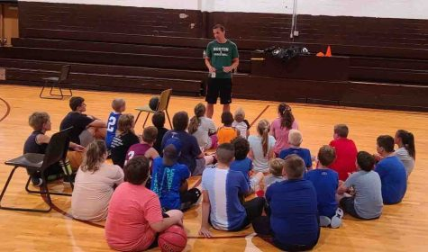 Former Whitesburg and Transylvania basketball standout Bryan Howard talked to participants in the Monday Night Dribbles program last week at the Loyall Elementary School gym. League director Eddie Creech said 25 students participated in the workouts.