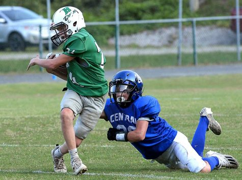 Harlan's Donald Sharp twisted away from a Letcher Central defender in middle school football action Tuesday. The Green Dragons fell 24-12.
