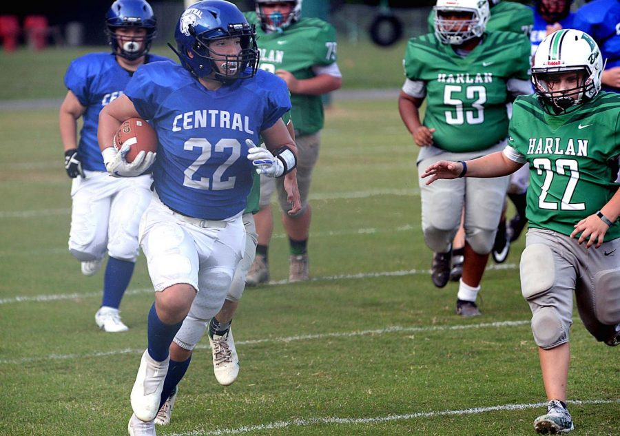 Letcher Central running back Garrett Howard broke away for a long run as Harlan's Caiden Jackson gave chase in middle school football action Tuesday. Howard scored a touchdown and led the Cougars in rushing in a 24-12 victory.